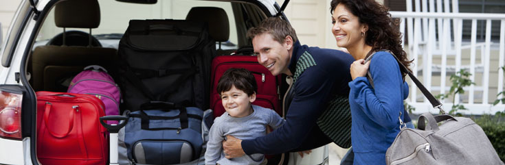 family packing a car for a trip